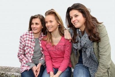 Teenage girls on school bench